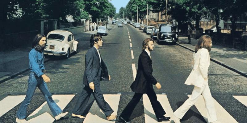 Slavným se stal jako zakládající člen skupiny The Beatles, ve které byl hlavním zpěvákem a rytmickým kytaristou skupiny.